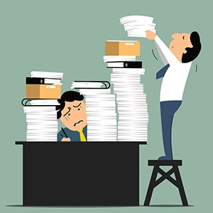 Stressful business man in office with too many stack of paper and folder on his desk. Business concept in overload work and very busy.