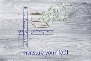 metaphor of measuring success, money exploding out of suitcase with rulers